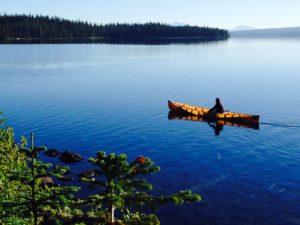 Russ Woodward paddling on Waldo Lake in Oregon - www.PaddlePeople.us