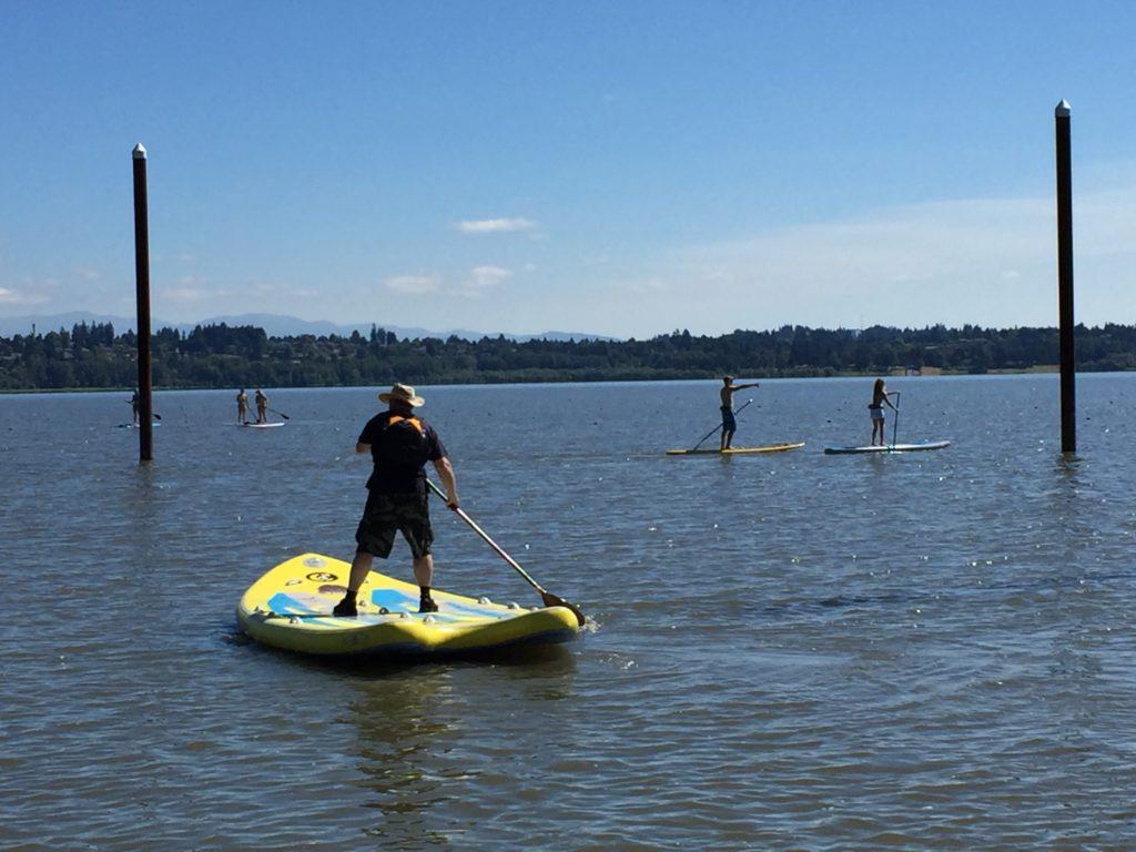 c4-watermand-supsquatch-jeff-catlin-paddling-at-vancouver-lake-park-washington