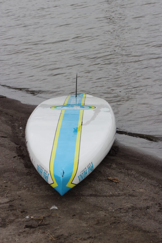 pau-hana-cadence-hull-on-beach-at-vancouver-lake-washington-paddle-people