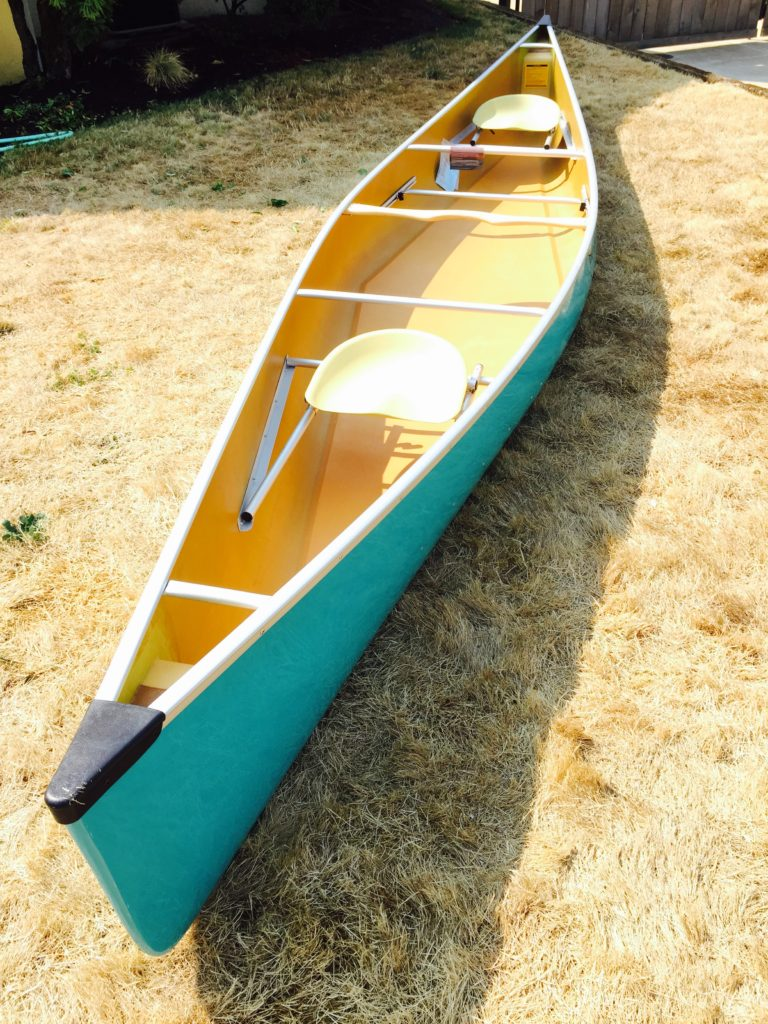 wenonah-spirit-2-aqua-blue-top-bow-shot-on-lawn-paddle-people-portland-oregon