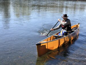 Canoeing with a dog in a Wenonah Encounter